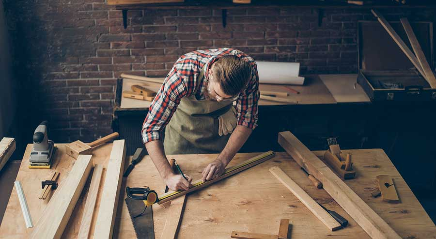 carpenter working on furniture